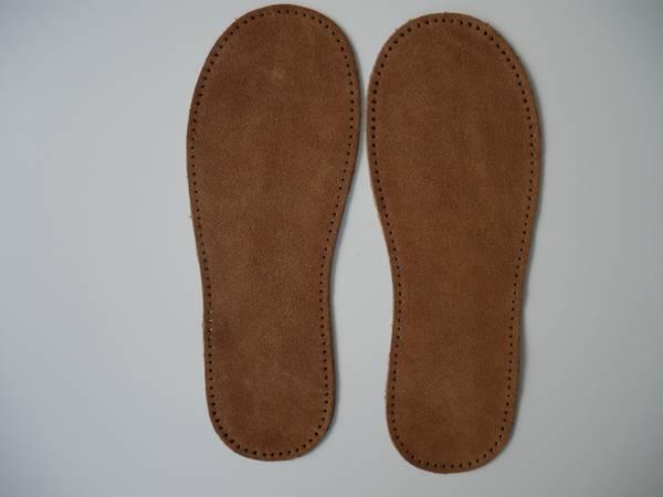 Bilde av Skinnsåler til tova tøfler, voksne, med hullkant,